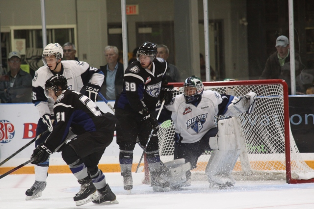 Graham Black and Levi Bews in front of the Saskatoon goal (Photo by Darwin Knelsen)
