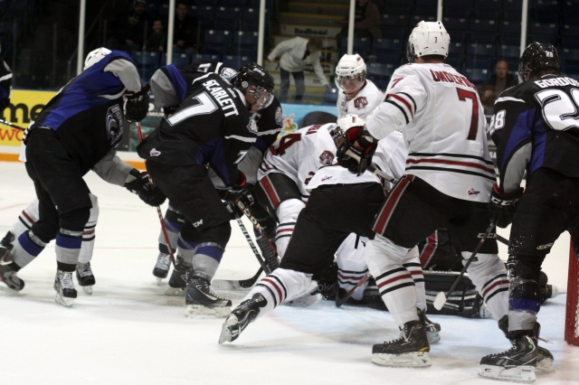 Reece Scarlett battles for a puck against the Rebels (Photo by Darwin Knelsen)
