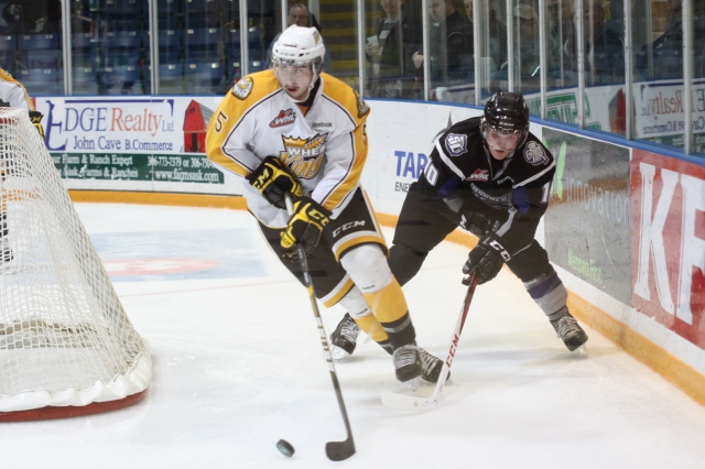 Colby Cave chasing the puck (Photo by Darwin Knelsen)