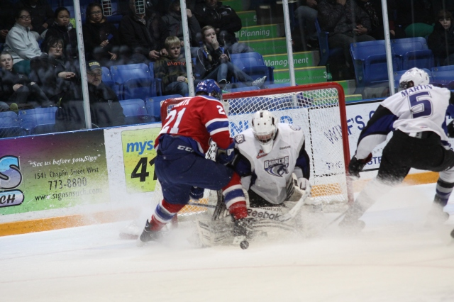 Eetu Laurikainen hangs on with Travis Ewanyk on the doorstep (photo by Darwin Knelsen)