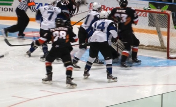 Macek (11) in the midst of making the glove pass (photo from scbroncos.com)