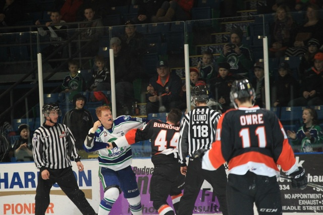 Cave fights Burroughs (photo by Darwin Knelsen for scbroncos.com)